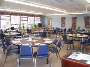Tables and chairs set up in the dining room