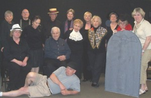 Group photo of people in costumes and holding props
