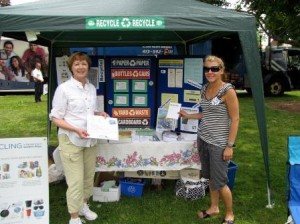 2 Women in Front of Recycling Tent and Display