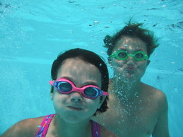 Kids under water at pool